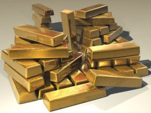 Goldbarren mit 24 karat auf einem Haufen